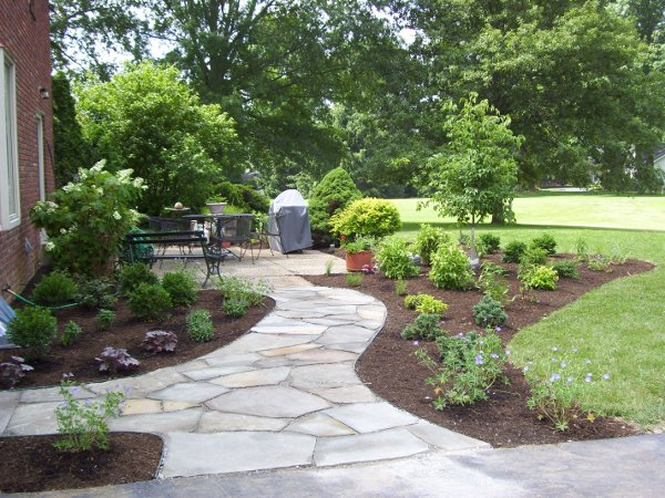 Natural stone walkway with landscaping