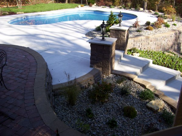 Retaining wall, paver patio with landscaping and rock integration
